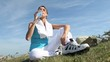 Woman in fitness outfit drinking water from bottle