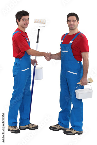 duo of craftsmen shaking hands