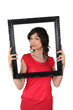 brunette red tunic holding frame