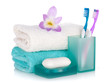 Toothbrushes, soap, two towels and flower