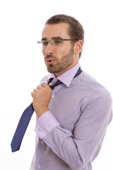 Businessman showing relief attitude after loosening his necktie.
