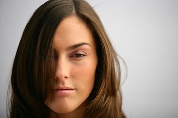 Stone faced brunette