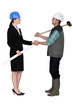 craftsman and businesswoman shaking hands