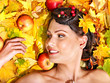 Woman holding autumn fruit.