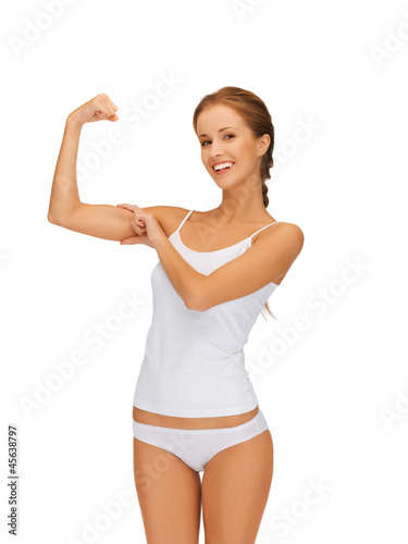 woman in cotton undrewear flexing her biceps