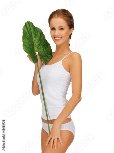 lovely woman with green leaf