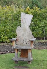 An Unusual Wooden Chair in a Garden Setting.