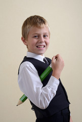 brave schoolboy with big pencil