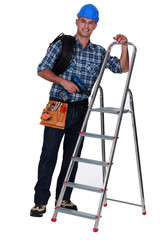 Tradesman standing next to a stepladder