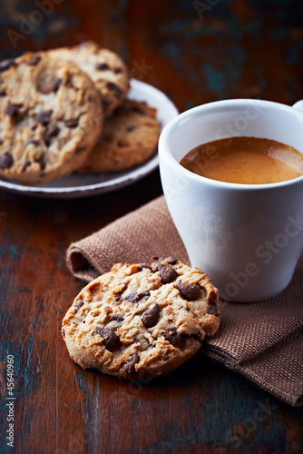 Cup of espresso and chocolate chip cookies
