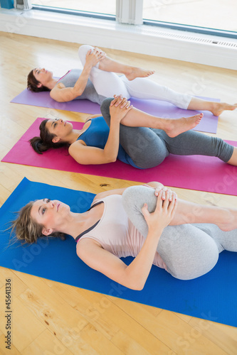 Women stretching on the floor