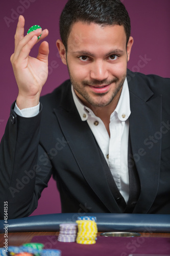 Man holding chip between his fingers
