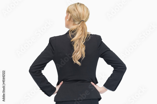 Businesswoman standing and thinking