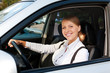 woman driving the car and smiling