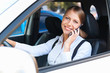 woman driving the car and talking on the phone