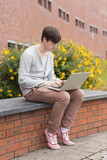 Student using laptop outside