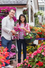 Couple holding bouquet and basket