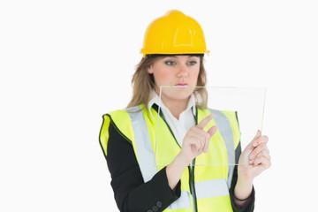Female architect touching on a pane