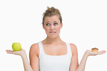 Woman deciding to eat healthy or not