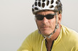 Closeup portrait of mature man wearing a cycling helmet