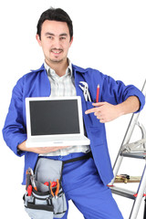 Electrician with computer and equipment