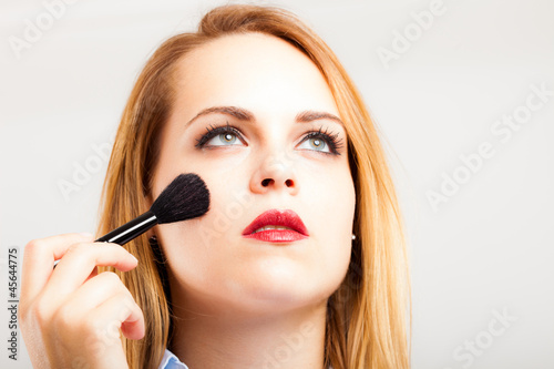 Woman applying blusher