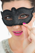 Woman wearing a black mask