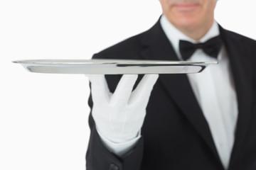 Waiter balancing silver tray