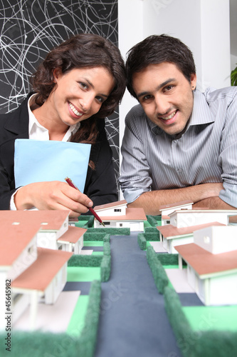 Architects posing with their building model