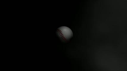 Baseball ball fading in the dark.
