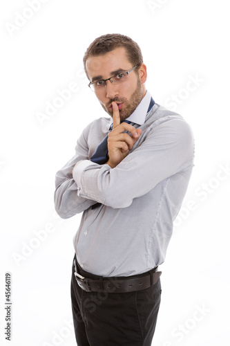 Secretive business man making silence sign.