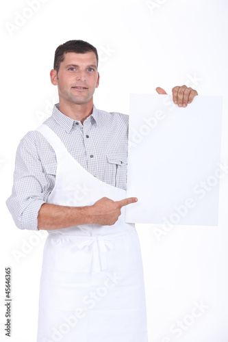 butcher showing a white panel