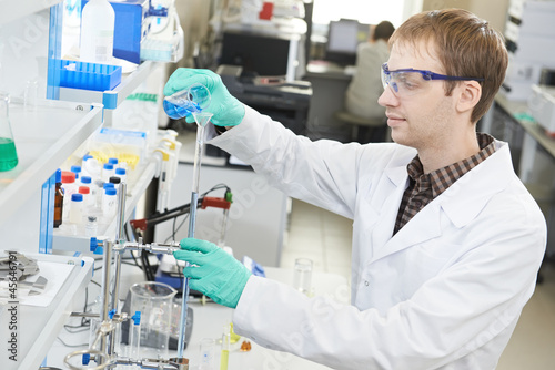Man chemist scientist researcher in laboratory