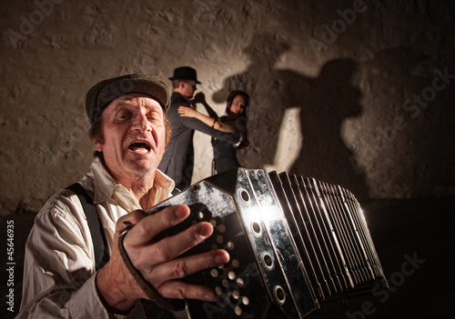 Accordion Player Singing For Dancers