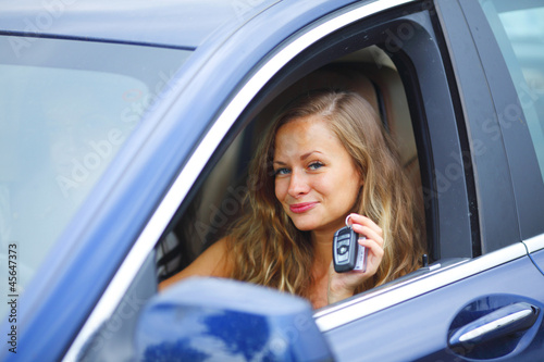woman holding keys from car