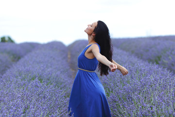 Woman standing on a lavender field