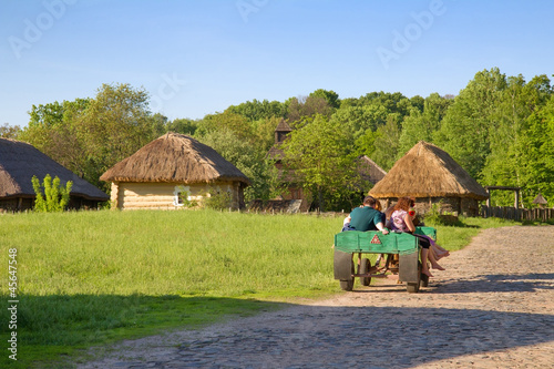 People sitting in the wooden cart