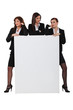 Sassy businesswomen with a board left blank for your message