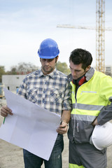 Foreman and colleague checking construction progress