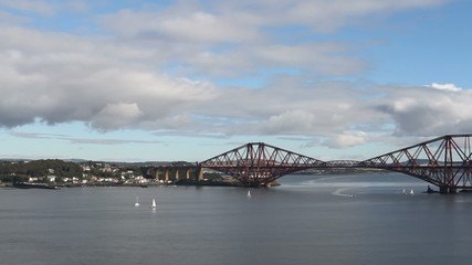 Yachts on Firth of Forth with Forth Rail Bridge Scotland