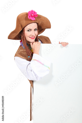 Woman in fancy dress holding message board