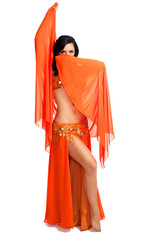 Belly dancer wearing orange costume and veil
