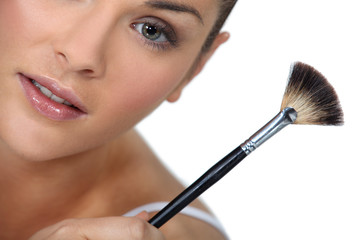Brunette holding make-up brush