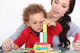 Woman and child playing with building blocks