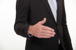 Cropped picture of a businessman about to shake hand.