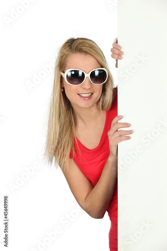 Woman in sunglasses with a blank board