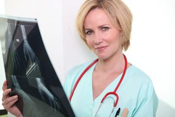 Female nurse holding x-ray image
