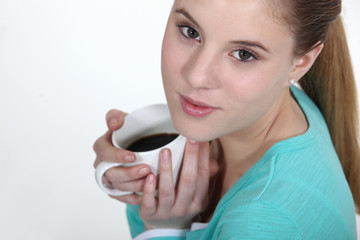 Young woman holding mug of coffee