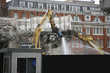 Large jackhammer smashing buildings
