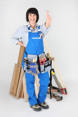 Woman carpenter with thumb up